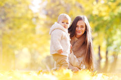 Mother and child in autumn park Stock Image