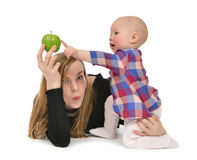 Mother and child baby boy kid with green apple Royalty Free Stock Photos