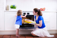 Mother and child baking a cake. Royalty Free Stock Photography
