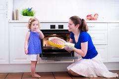 Mother and child baking a cake. Royalty Free Stock Images
