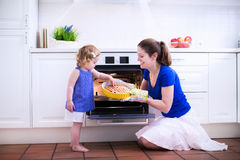 Mother and child baking a cake. Royalty Free Stock Image