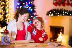 Mother and child baking Christmas cookies Stock Photography
