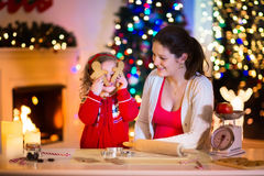 Mother and child baking Christmas cookies Royalty Free Stock Photos