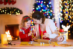 Mother and child baking Christmas cookies Royalty Free Stock Images