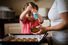 Mother and child baking together Royalty Free Stock Images