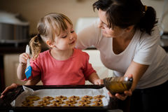 Mother and child baking together Royalty Free Stock Photos