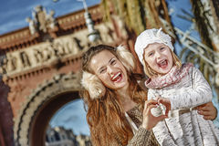 Mother and child in Barcelona showing heart shaped hands Stock Photography