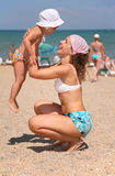 Mother with child on a beach royalty free stock photo