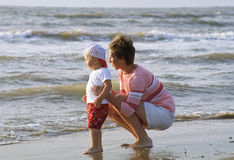 Mother and child on a beach. Mother and baby on a beach stock photography