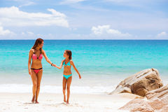 Mother with child on a beach Stock Images