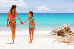 Mother with child on a beach Stock Photos