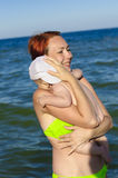 Mother and child on the beach in the sea swim Stock Images