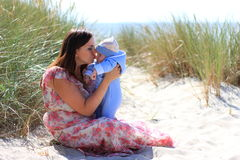 Mother and child. Mother with the child on a beach in the summer Royalty Free Stock Photography