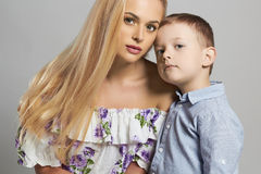 Mother and Child. Beautiful Blond Woman with Little Son. Happy Family Royalty Free Stock Image