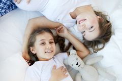 Mother and Child on Bed Above View royalty free stock photography