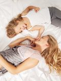 Mother with child in bed Stock Image