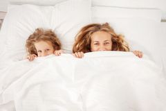 Mother with child in bed Royalty Free Stock Photos