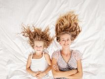 Mother with child in bedroom stock image