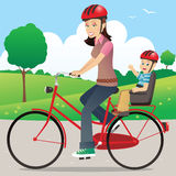 Mother and child on bicycle Stock Photo