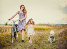 Mother with the child and bike Stock Photos