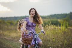 Mother with the child and bike. Mother with her baby and a bike ride in nature Royalty Free Stock Photos