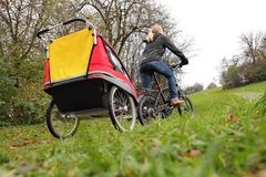 Mother with child bike trailer Royalty Free Stock Photo