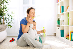 Mother and child blowing bubbles Royalty Free Stock Image