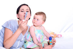Mother and child blowing bubbles Royalty Free Stock Images