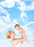 Mother and Child Bond in Clouds Stock Photography