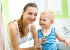 Mother with child boy brushing teeth Royalty Free Stock Photo