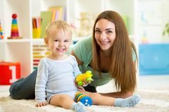 Mother and child boy play together indoor Stock Images