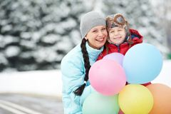 Mother with child boy son at winter. Portrait of happy mother with little child son boy and in winter outdoors Royalty Free Stock Photography