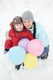 Mother with child boy son at winter. Portrait of happy mother with little child son boy and in winter outdoors Stock Photo