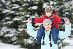 Mother with child boy son at winter Stock Photo