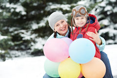 Mother with child boy son at winter. Portrait of happy mother with little child son boy and in winter outdoors Royalty Free Stock Photos