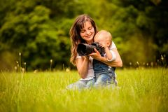 Mother, child and camera Stock Photography