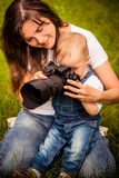 Mother, child and camera Stock Photos