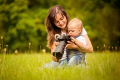 Mother, child and camera Stock Images
