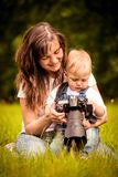 Mother, child and camera Royalty Free Stock Photography
