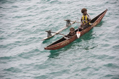 Mother and child in canoe on Pacific Ocean Royalty Free Stock Photo