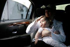 Mother with child in car Stock Images