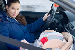Mother and child in car safety seat Stock Photo
