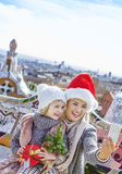 Mother and child with cellphone taking selfie at Guell Park Stock Photos