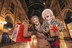 Mother and child with Christmas present box in Milan rejoicing Royalty Free Stock Images