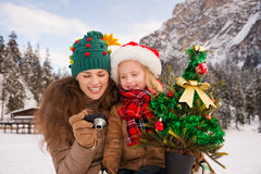 Mother and child with Christmas tree checking photos in camera Royalty Free Stock Photos