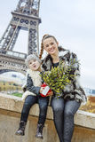 Mother and child with Christmas tree having fun time in Paris Stock Photos