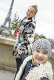 Mother and child with Christmas tree in Paris having fun time Royalty Free Stock Images