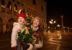 Mother and child with Christmas tree on Piazza San Marco, Venice Royalty Free Stock Photo