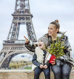 Mother and child with Christmas tree pointing on something Stock Photo