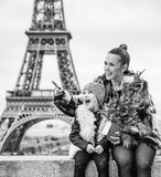Mother and child with Christmas tree pointing on something. The Party Season in Paris. happy trendy mother and child with Christmas tree in the front of Eiffel stock photography